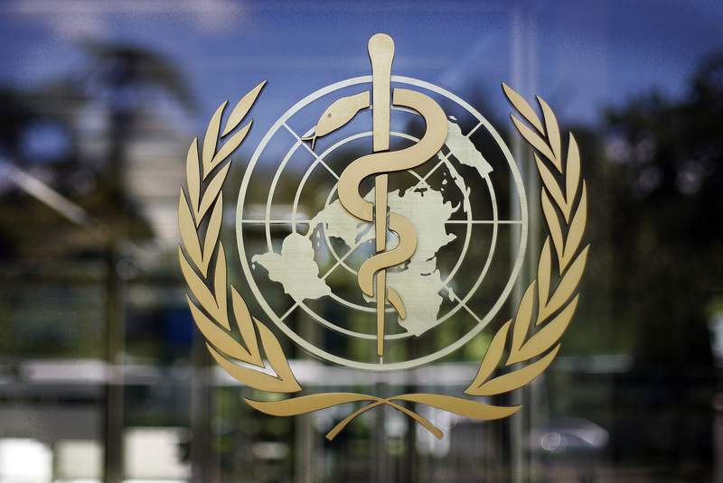FILE - In this Thursday, June 11, 2009 file photo, the logo of the World Health Organization is seen at the WHO headquarters in Geneva, Switzerland. An independent panel appointed by the World Health Organization to review the U.N. health agencys coordination of the response to the COVID-19 pandemic said on Thursday, Sept. 3, 2020 it would have full access to any internal U.N. agency documents, materials and emails necessary as the group begins their probe. (AP Photo/Anja Niedringhaus, file)