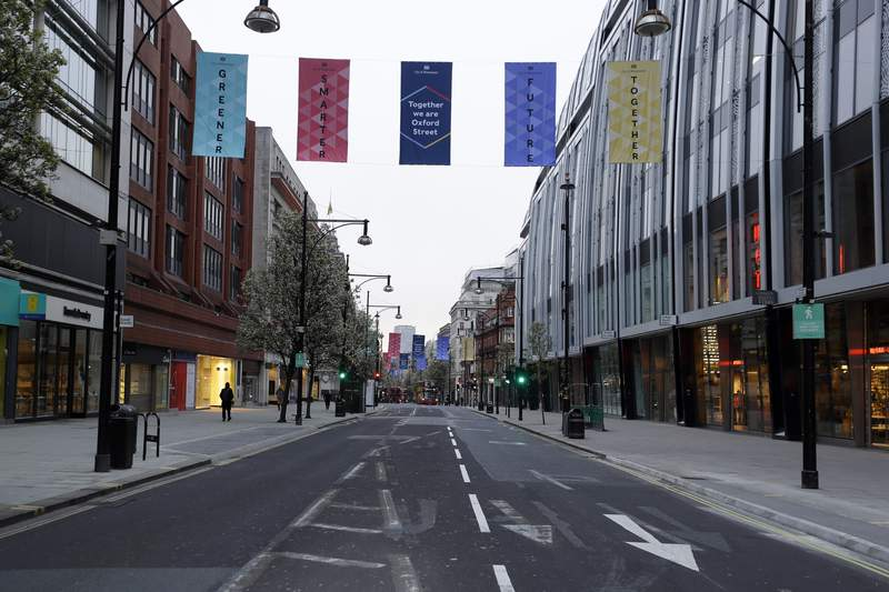 FILE - In this Monday, April 12, 2021 file photo, empty Oxford Street in London before shops open at 7:00am, after coronavirus measures were lifted. A well-respected economic think tank says households in Britain, especially poorer ones, are far more likely to have suffered a severe income shock during the coronavirus pandemic over the past year than their counterparts in France and Germany. The Resolution Foundation also said Wednesday, April 21, 2021 that households in the U.K. are also more likely to have run up more debt in response to the financial shockwaves emanating from the pandemic. (AP Photo/Kirsty Wigglesworth, File)
