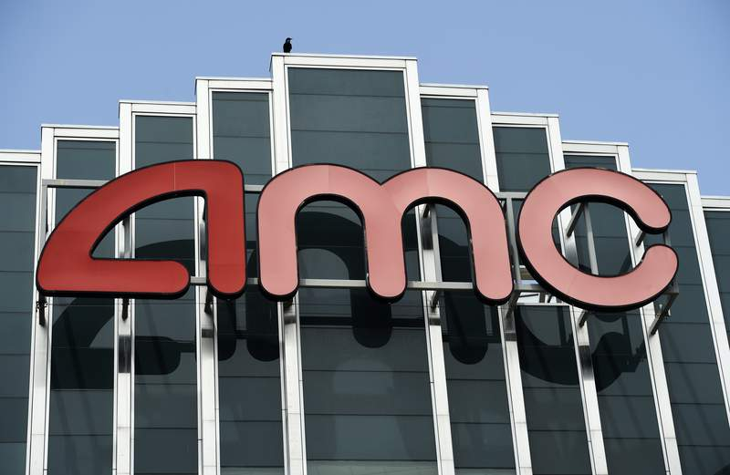 FILE - In this April 29, 2020 file photo, the AMC sign appears at AMC Burbank 16 movie theater complex in Burbank, Calif. AMC Theaters, the nations largest chain, is pushing back its plans to begin reopening theaters by two weeks. The company said Monday that it would open approximately 450 U.S. locations on July 30 and the remaining 150 the following week. (AP Photo/Chris Pizzello, File)