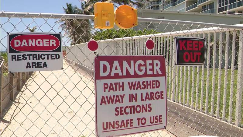 """Public pathway blocked by """"Danger"""" signs put up by beachside condo"""