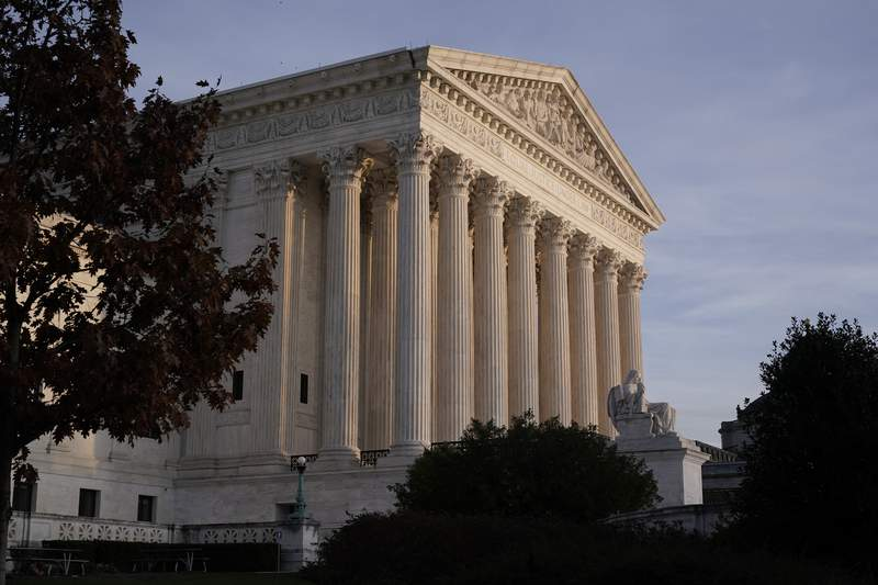 FILE - In this Nov. 5, 2020, file photo the Supreme Court is seen in Washington. The court prepares to hear arguments Tuesday in the third major legal challenge to the Affordable Care Act. (AP Photo/J. Scott Applewhite, File)