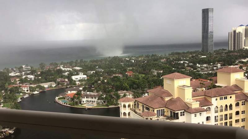 Watch large waterspout form just off the coast of South Florida