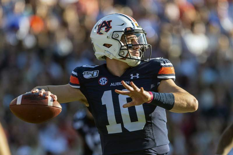 FKILE - In this Saturday, Nov. 30, 3019, file photo, Auburn quarterback Bo Nix (10) throws against Alabama during the first half of an NCAA college football game, in Auburn, Ala. Terry Wilson has waited for football's return even longer than most of his Southeastern Conference brethren. No. 23 Kentucky's quarterback will take the field again Saturday, Sept. 26, 2020, at No. 8 Auburn, returning from a knee injury that cost him almost all of last season. His Tigers' counterpart in the SEC's opening weekend is Bo Nix, coming off a strong freshman season.(AP Photo/Vasha Hunt, File)