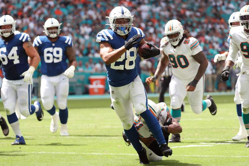 Jonathan Taylor of the Indianapolis Colts runs the ball in the game against the Miami Dolphins during the second quarter at Hard Rock Stadium on October 03, 2021 in Miami Gardens, Florida.