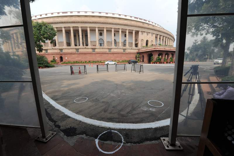 FILE- In this Sept.14, 2020 file photo, markings to maintain physical distancing are seen on the ground outside the Parliament building in New Delhi, India. Indias government is repealing a controversial tax law under which it pursued billions of dollars from international companies for their past dealings and hopes that scrapping the retrospective levy boosts investor confidence. The bill approved in Parliaments upper house Monday proposes to withdraw tax demands made over indirect transfers of Indian assets prior to May 2012.(AP Photo, File)