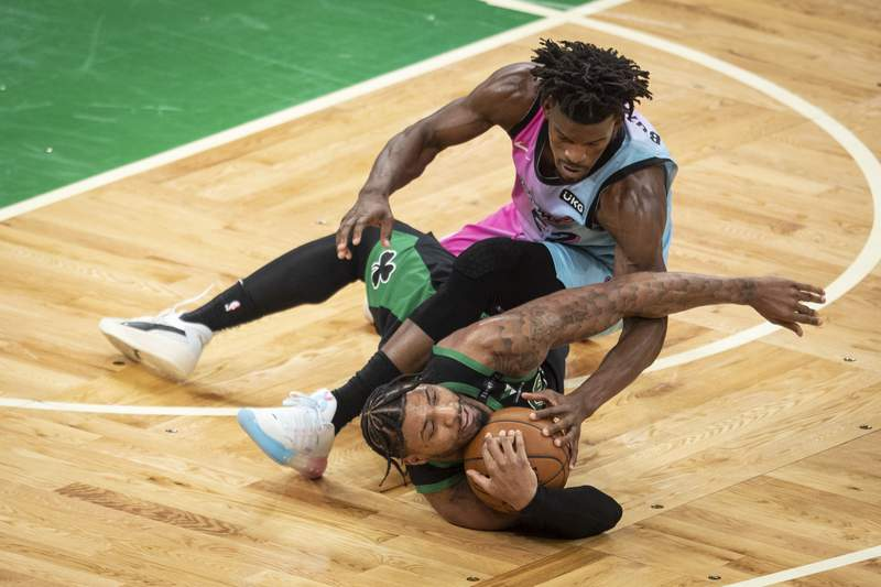 Jimmy Butler of the Miami heat and Marcus Smart of the Boston Celtics battle for the ball during the second half at TD Garden on May 09, 2021 in Boston, Massachusetts.