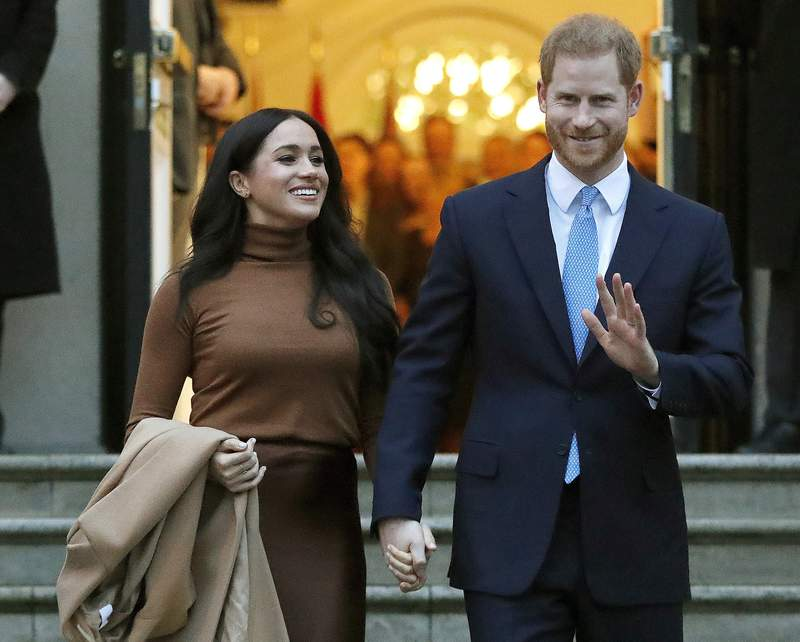 FILE - In this Tuesday, Jan. 7, 2020 file photo, Britain's Prince Harry and Meghan, Duchess of Sussex leave after visiting Canada House in London. The Duke and Duchess of Sussex say they will no longer cooperate with several British tabloid newspapers because of what they call distorted, false or invasive stories. Meghan and Harry have written to the editors of The Sun, the Daily Mail, the Daily Express and the Daily Mirror saying they wont offer themselves up as currency for an economy of click bait and distortion. They say stories based on salacious gossip have upended the lives of acquaintances and strangers alike. (AP Photo/Frank Augstein, File)