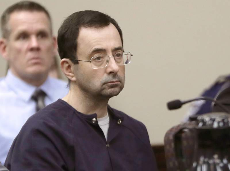 """FILE - In this Jan. 24, 2018, file photo, Larry Nassar, a former doctor for USA Gymnastics and member of Michigan State's sports medicine staff, sits in court during his sentencing hearing in Lansing, Mich. The FBI made numerous serious errors in investigating allegations against former USA Gymnastics national team doctor Larry Nassar and didn't treat the case with the utmost seriousness, the Justice Department's inspector general said Wednesday, July 24, 2021. The FBI acknowledged conduct that was inexcusable and a discredit"""" to America's premier law enforcement agency. (AP Photo/Carlos Osorio, File)"""