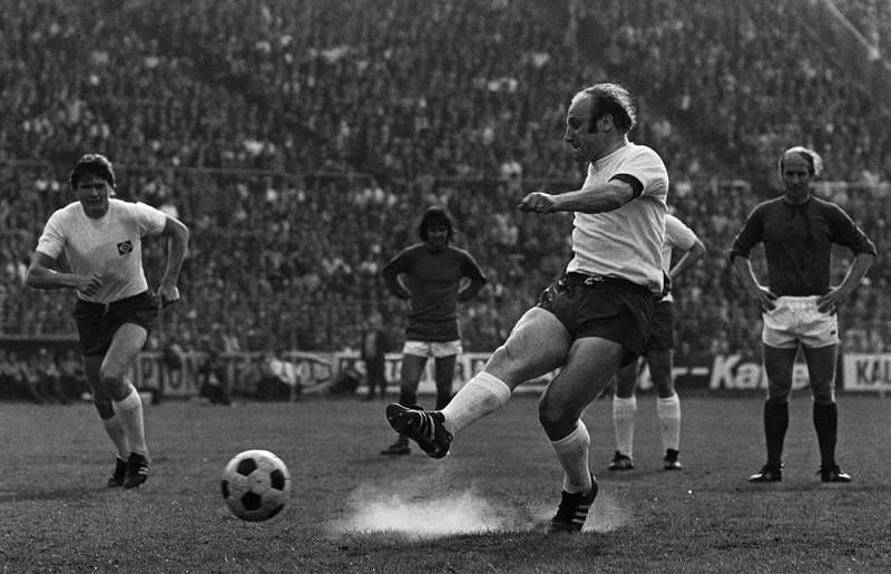 FILE - In this May 1, 1972 file photo German soccer star Uwe Seeler shoots a penalty during his farewell match in Hamburg, Germany. Former West Germany and Hamburger SV forward Uwe Seeler is to have an operation for a broken hip after a bad fall at home. (AP Photo/Helmuth Lohmann, file)