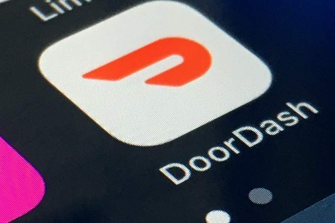 FILE - The DoorDash app is shown on a smartphone on Feb. 27, 2020, in New York.  DoorDash Inc. reports quarterly financial results after the market close on Thursday, May 13, 2021.  (AP Photo, File)