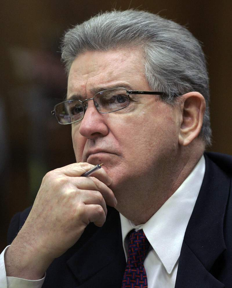 FILE- In this Oct. 15, 2008 file photo, former FBI agent John Connolly listens to the testimony during his trial in Miami. The imprisoned former FBI agent serving a 40-year prison sentence for alerting former Boston mobster Whitey Bulger that he could implicated in a mob murder wants to be released from prison on medical grounds. Connolly will ask the Florida Commission on Offender Review Wednesday, Feb. 17, 2021 to release him. (AP Photo/Alan Diaz, File)