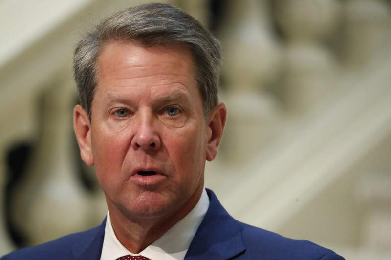FILE - In this July 17, 2020, file photo, Georgia Gov. Brian Kemp speaks during a coronavirus briefing at the Capitol, in Atlanta. Republican Gov. Kemp and his wife are quarantining after being exposed to someone who tested positive for COVID-19, his spokesman announced Friday, Oct. 30. (AP Photo/John Bazemore, File)