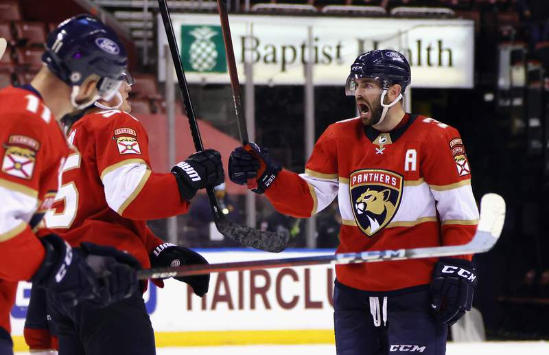 Keith Yandle of the Florida Panthers celebrate a win over the Detroit Red Wings at the BB&T Center on March 30, 2021 in Sunrise, Florida.