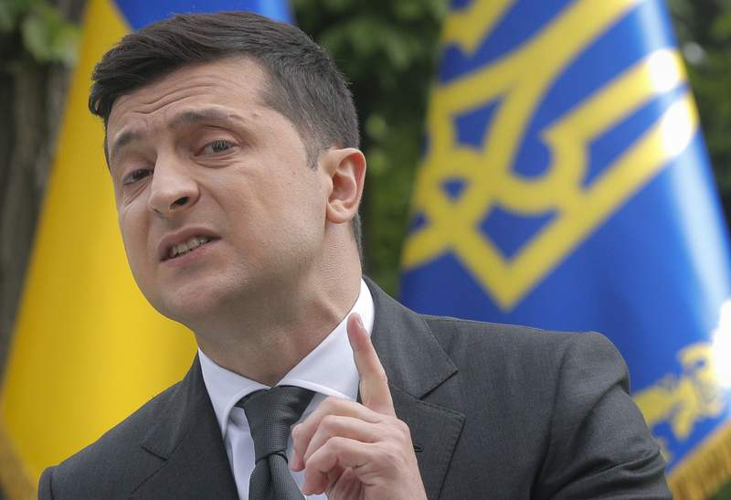 Ukraine's President Volodymyr Zelenskiy speaks to the media during a news conference in Kyiv, Ukraine, Wednesday, May 20, 2020. At the press conference marking Zelenskiy's one year in office, the president answered questions about domestic affairs, foreign policy and his main achievements. (Sergey Dolzhenko/Pool Photo via AP)