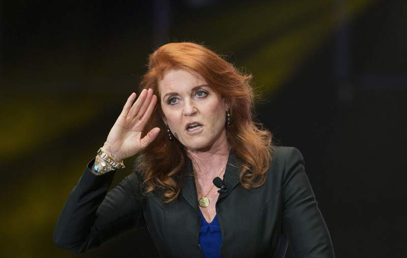 FILE - In this Monday, March 7, 2016 file photo, Sarah Ferguson, Duchess of York, salutes during a press event, in Mexico City. Ferguson has landed a book deal for her debut novel for adults, a historical romance fictionalizing the life and loves of her great-great-great aunt. In a promotional video posted on her Twitter account Wednesday, Jan. 13, 2021 the former Sarah Ferguson said the novel is set in the Victorian era and is about daring to follow your heart against the odds. (AP Photo/Rebecca Blackwell, file)