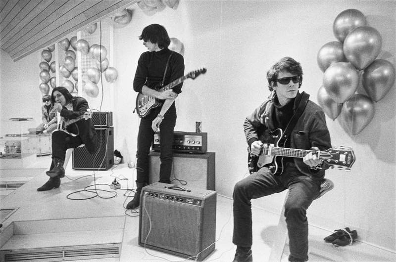 "This image released by Apple TV+ shows Moe Tucker, John Cale, Sterling Morrison and Lou Reed from the documentary ""The Velvet Underground."" (Nat Finkelstein Estate/Apple TV+ via AP)"