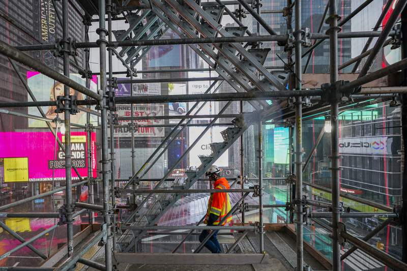 A construction worker walks down a staircase in the scaffolding of TSX Broadway under construction, Thursday, Oct. 29, 2020, in New York's, Times Square. The 46-story mixed-use property will house 75,000 square feet of retail space, a 4,000-square-foot performance venue including an outdoor stage, an outdoor food and beverage terrace and a luxury hotel. U.S. construction spending rose 0.3% in September, the fourth straight monthly gain after a coronavirus-caused spring swoon. (AP Photo/Mary Altaffer)