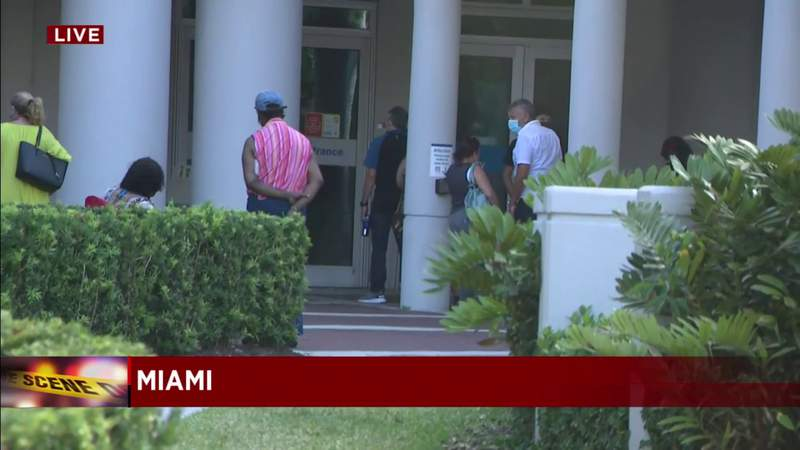 Relatives wait outside hospital after mass shooting at rapper's party in Miami-Dade