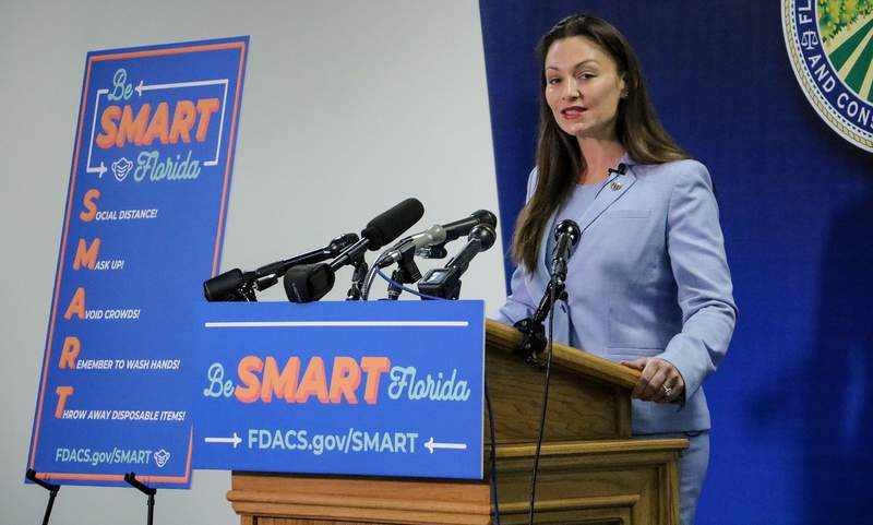 In this file photo, Florida Agriculture Commissioner Nikki Fried unveils a campaign aimed at encouraging residents to wear masks.