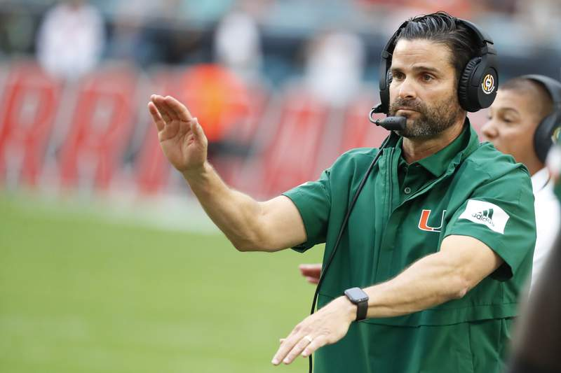 FILE - In this Saturday, Nov. 9, 2019 file photo, Miami head coach Manny Diaz calls out a play during the first half of an NCAA college football game against Louisville in Miami Gardens, Fla.  (AP Photo/Wilfredo Lee, File)