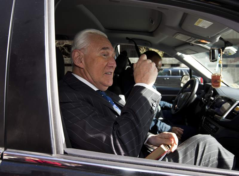 FILE - In this Nov. 15, 2019, file photo, Roger Stone leaves federal court in Washington. The Justice Department has sued former President Donald Trump's ally Stone, accusing him and his wife of failing to pay nearly $2 million in income tax.  (AP Photo/Jose Luis Magana, File)