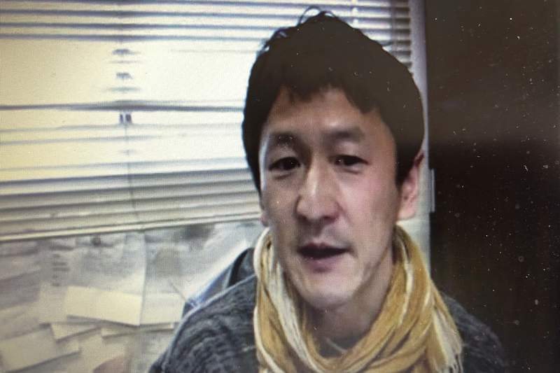 In this screen shot image made from a video news conference by Foreign Correspondents' Club of Japan (FCCJ) in Tokyo, Japanese professor Kentaro Iwata speaks Monday, April 20, 2020. Iwata says he is very pessimistic the Olympics can be held next year in Japan. (FCCJ via AP)