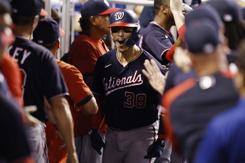 Tres Barrera of the Washington Nationals celebrates with teammates after hitting a two-run home run against the Miami Marlins during the fourth inning at loanDepot park on August 24, 2021 in Miami, Florida.