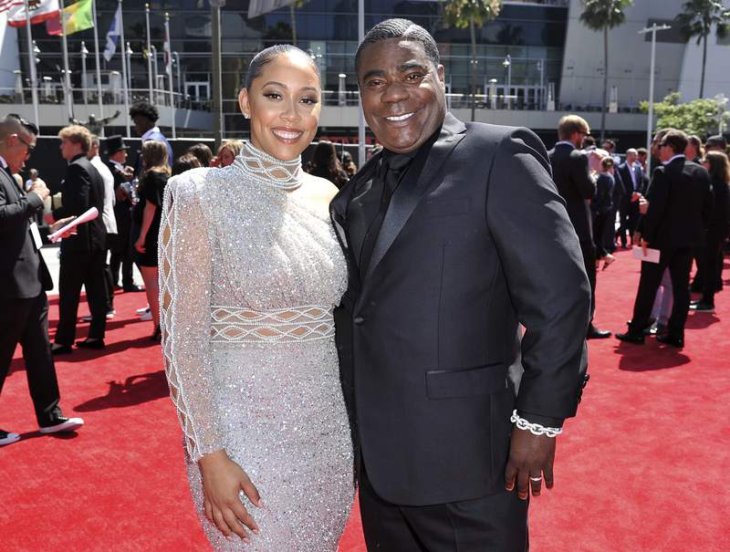 """FILE - Megan Wollover, left, and Tracy Morgan arrive at the ESPY Awards on July 10, 2019, in Los Angeles. Morgan and his wife of five years will part ways. The actor-comedian's representative said in an emailed statement Wednesday that Morgan and Wollover have filed for divorce. Morgan and Wollover married after the former """"Saturday Night Live"""" cast member recovered from a 2014 highway crash in which a Wal-Mart truck slammed into the back of a limo Morgan was riding in. (Photo by Richard Shotwell/Invision/AP, File)"""