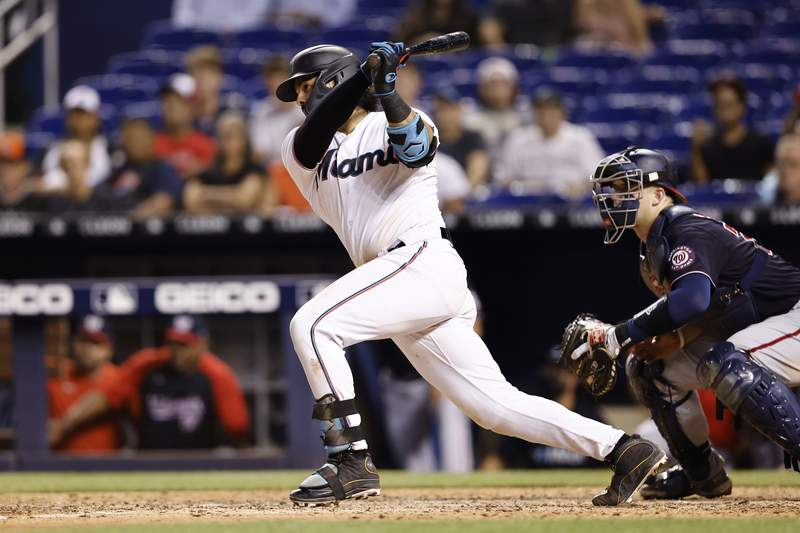 Jorge Alfaro of the Miami Marlins hits a walk-off RBI single during the tenth inning against the Washington Nationals  at loanDepot park on August 25, 2021 in Miami, Florida.