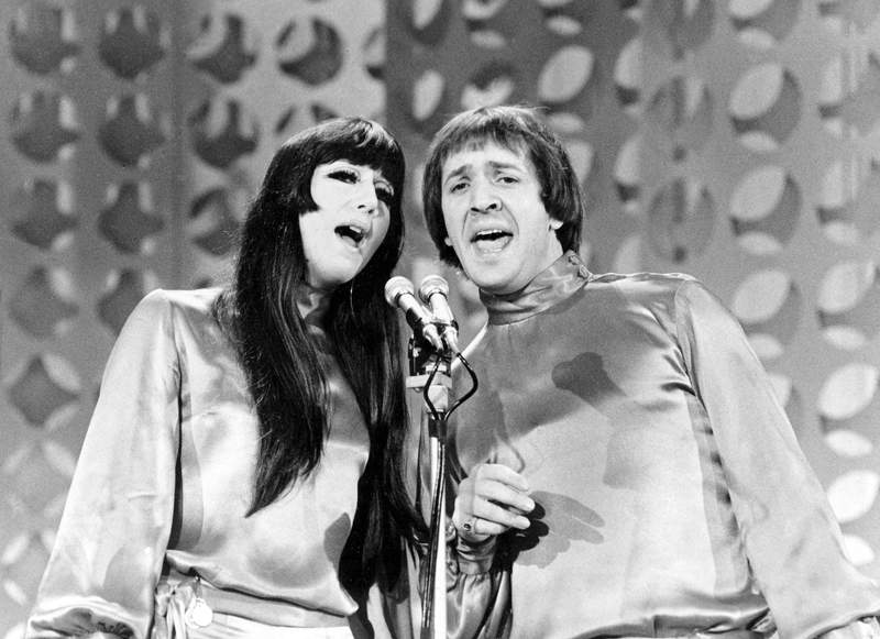 """FILE - In this Jan. 21, 1966 file photo, Sonny, right, and Cher sing during a taping of """"The Danny Thomas Special"""" in Los Angeles. Cher has sued the widow of her former musical partner and ex-husband Sonny Bono over royalties for Sonny and Cher songs including I Got You Babe and The Beat Goes On."""" In a federal lawsuit filed Wednesday, Oct. 13, 2021, Cher alleges that former Rep. Mary Bono and other defendants have attempted to terminate provisions of business agreements Cher and Sonny Bono reached when they divorced in 1975 that entitled each to 50% of songwriting and recording royalties. (AP Photo/File)"""
