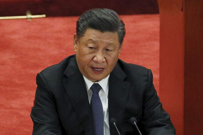 FILE - In this Oct. 23, 2020, file photo, Chinese President Xi Jinping delivers his speech at the commemorating conference on the 70th anniversary of the Chinese army entering North Korea to resist the U.S. army at the Great Hall of the People in Beijing. Xi will take part in President Joe Bidens climate summit this week, the government announced Wednesday, April 21, 2021. (AP Photo/Andy Wong, File)