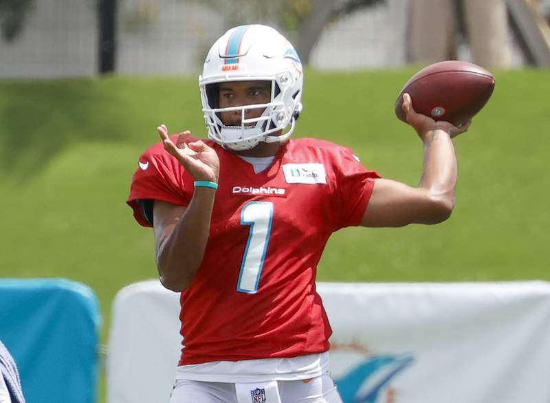 Tua Tagovailoa of the Miami Dolphins throws the ball at the Baptist Health Training Complex on August 25, 2021 in Miami Gardens, Florida.