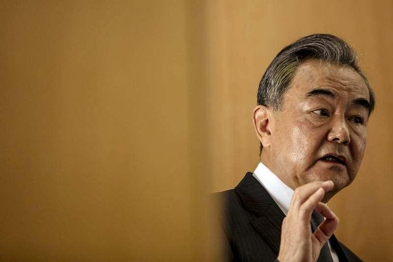 """FILE - In this Aug. 30, 2020 file photo, Chinese Foreign Minister Wang Yi delivers a speech during a press conference at the Institute for International Relations in Paris. China on Tuesday, Sept. 8, 2020 unveiled its own initiative to address global data security issues, a countermove that comes a month after the U.S. announced its """"clean network"""" program aimed at discouraging other countries from using Chinese technology. Chinese foreign minister Wang Yi announced the initiative at a seminar on global digital governance. (AP Photo/Kamil Zihnioglu, File)"""
