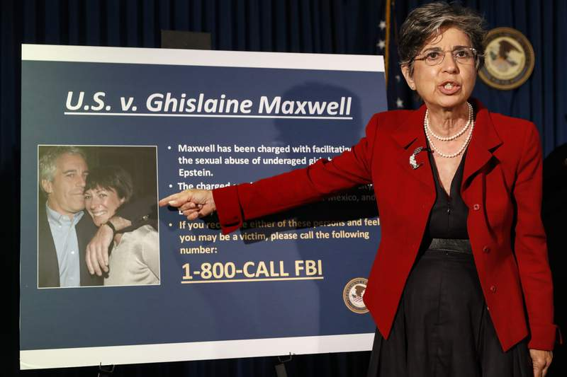 FILE- In this July 2, 2020 file photo, Audrey Strauss, Acting United States Attorney for the Southern District of New York, points to a photo of Jeffrey Epstein and his ex-girlfriend Ghislaine Maxwell. Sex trafficking charges were added Monday, March 29, 2021 to the indictment against financier Jeffrey Epsteins ex-girlfriend as prosecutors alleged that she groomed a 14-year-old girl to recruit other young females in the early 2000s to provide sexualized massages to Epstein in return for cash. (AP Photo/John Minchillo, File)
