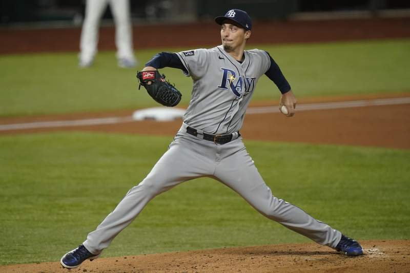 FILE - In this Tuesday, Oct. 27, 2020, file photo, Tampa Bay Rays starting pitcher Blake Snell throws against the Los Angeles Dodgers during the first inning in Game 6 of the baseball World Series, in Arlington, Texas. The San Diego Padres finalized their acquisition of ace left-hander Snell from the Tampa Bay Rays on Tuesday, Dec. 29, 2020, sending four prospects in exchange for the 2018 AL Cy Young Award winner. (AP Photo/Eric Gay, File)