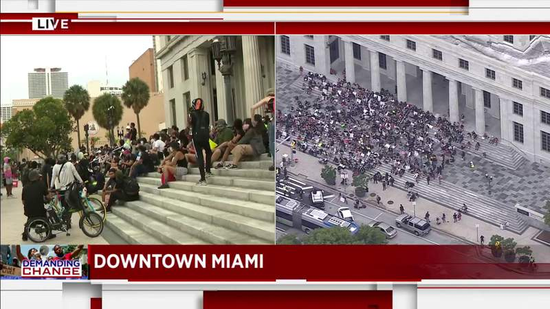 Protesters chant in front of Miami-Dade County Courthouse