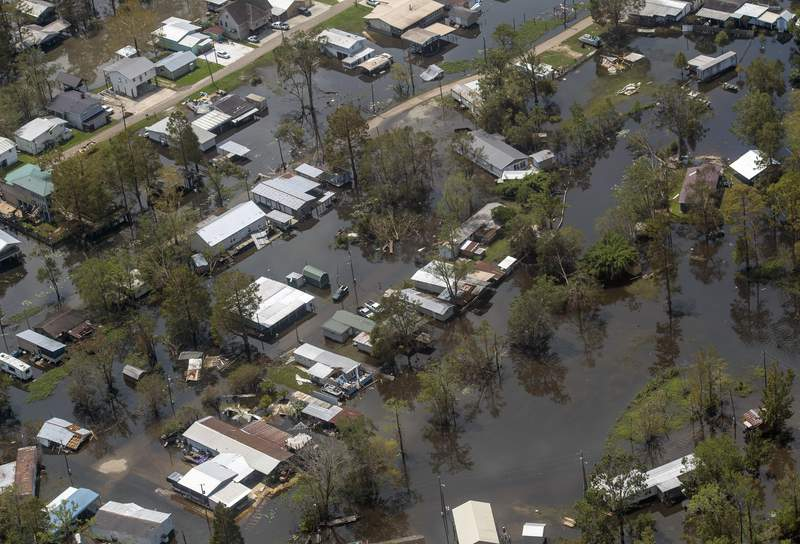 Flooding in French Settlement, La., is viewed Thursday Sept. 2, 2021, as Gov. John Bel Edwards took an aerial tour to assess Hurricane Ida damage and meet with local officials. (Bill Feig/The Advocate via AP, Pool)