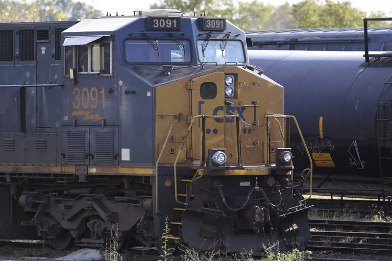 In this Oct. 14, 2019 photo a CSX locomotive rests on railroad tracks at a rail yard, in Framingham, Mass. CSX Corp. reports financial results Thursday, Jan. 16, 2020. (AP Photo/Steven Senne)