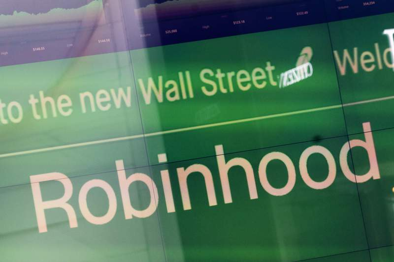 FILE - An electronic screen at Nasdaq displays Robinhood in New York's Times Square following the company's IPO, Thursday, July 29, 2021. Robinhood is buying a company that helps people communicate with the businesses whose shares they buy. Robinhood Markets said Tuesday, Aug. 10, 2021 that it agreed to buy Say Technologies for about $140 million in cash. (AP Photo/Mark Lennihan, File)