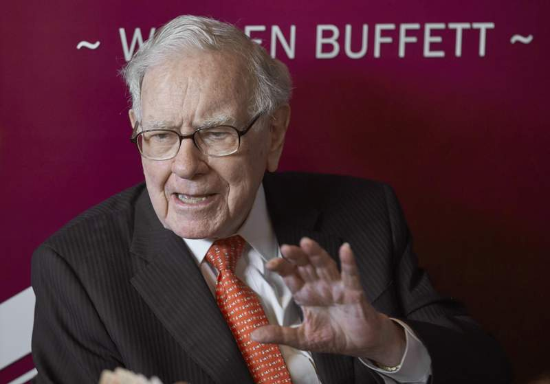 FILE - In this May 5, 2019, file photo Warren Buffett, Chairman and CEO of Berkshire Hathaway, speaks during a game of bridge following the annual Berkshire Hathaway shareholders meeting in Omaha, Neb. Investor Buffett's fortune surged above $100 billion Wednesday, March 10, 2021, when shares of his company hit a record high at over $400,000 apiece. (AP Photo/Nati Harnik, File)