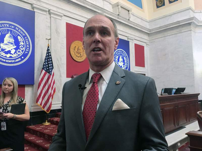 FILE - In this Monday, Jan. 28, 2019 file photo, West Virginia Senate President Mitch Carmichael discusses comprehensive education legislation inside the Senate chambers at the state Capitol in Charleston, W.Va. Carmichael, The West Virginia Senate president who was dogged by teacher protests at the statehouse, lost to a teacher in his Republican primary reelection bid Tuesday, June 9, 2020. Senate President Mitch Carmichael was defeated by Amy Nichole Grady, a teacher from Mason County who snagged the endorsement of the American Federation of Teachers West Virginia chapter. (AP Photo/John Raby, File)