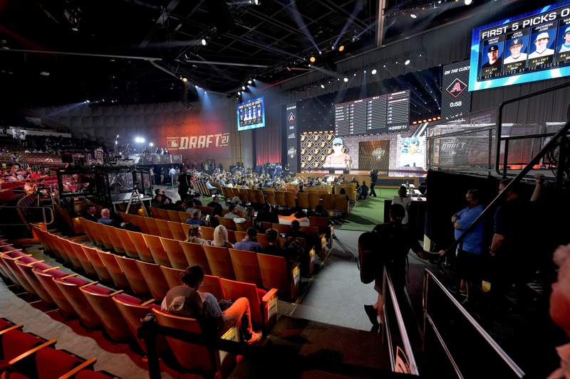 Fans watch during the first round of the 2021 MLB baseball draft, Sunday, July 11, 2021, in Denver. (AP Photo/David Zalubowski)