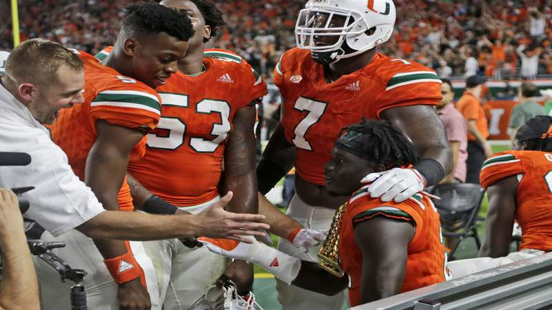 """Miami Hurricanes defensive back Trajan Bandy wears the """"turnover chain"""" after returning an interception for a touchdown against Notre Dame."""