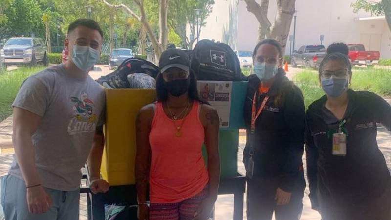Takira Brown collects donations from University of Miami in Coral Gables.