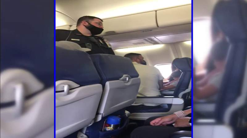 Flight fight leads to smoldering cell phone and diverted plane