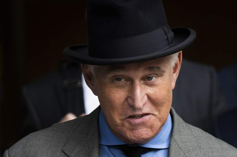 FILE - In this Nov. 12, 2019, file photo Roger Stone leaves federal court in Washington. A federal judge is giving Stone, a longtime ally and confidant of President Donald Trump, an additional two weeks before he must report to serve his federal prison sentence. (AP Photo/Manuel Balce Ceneta, File)