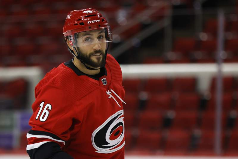 Vincent Trocheck of the Carolina Hurricanes looks on during the second period of their game against the Tampa Bay Lightning at PNC Arena on February 22, 2021 in Raleigh, North Carolina.