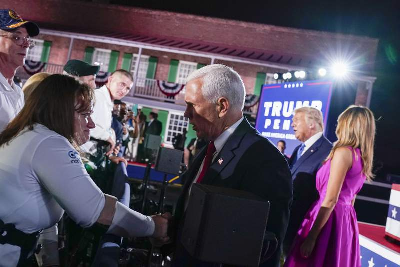 Vice President Mike Pence shakes hands after speaking on the third day of the Republican National Convention at Fort McHenry National Monument and Historic Shrine in Baltimore, Wednesday, Aug. 26, 2020. (AP Photo/Andrew Harnik)