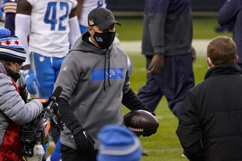 Detroit Lions head coach Darrell Bevell carries a game ball as he leaves the field following a 34-30 win over the Chicago Bears in an NFL football game in Chicago, Sunday, Dec. 6, 2020. (AP Photo/Charles Rex Arbogast)