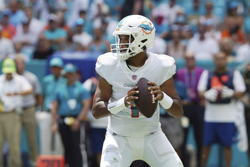 Miami Dolphins quarterback Tua Tagovailoa (1) looks to pass during the first half of an NFL football game against the Buffalo Bills, Sunday, Sept. 19, 2021, in Miami Gardens, Fla. (AP Photo/Hans Deryk)